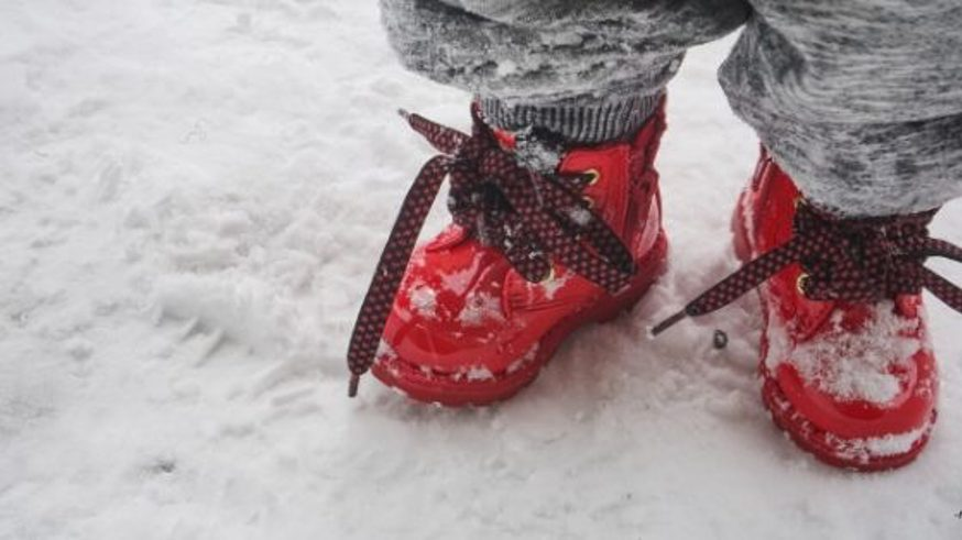 winter proofing yourself with red boots in the snow